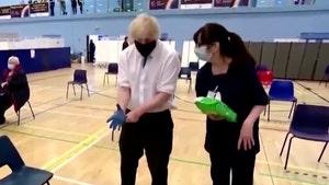 Boris Johnson Cracks O.J. Simpson Joke After Struggle W/ Gloves At Vaccine Site