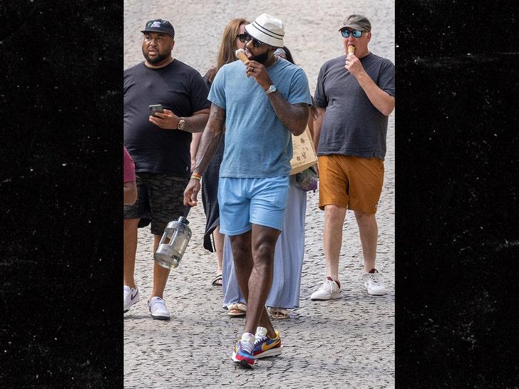 LeBron James Licks Ice Cream Cone While Strolling Through France.jpg