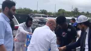 Dolphins Stars Jaylen Waddle & Jerome Baker Lend Hand At Miami Condo Collapse Site