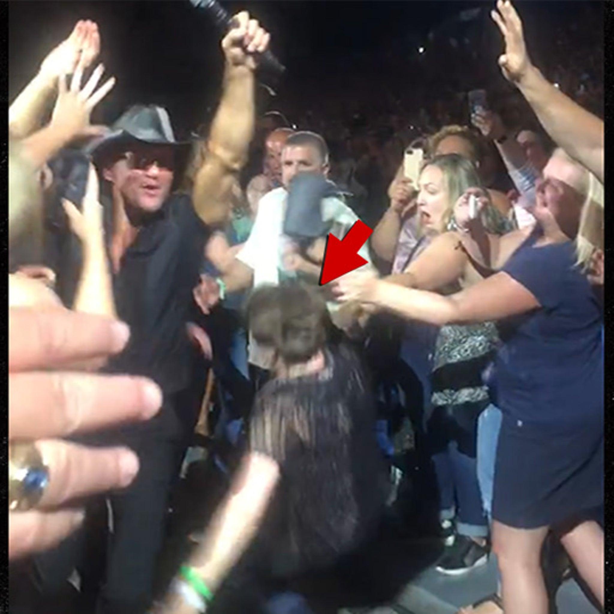 Tim McGraw Concert, Female Fan Falls Hard (VIDEO)