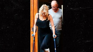 Pamela Anderson Hobbling on Crutches After French 'Dancing with the Stars' Injury