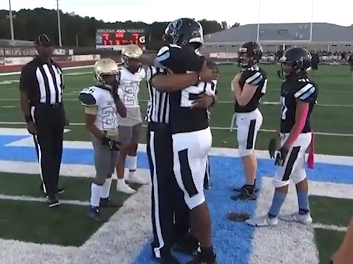 Soldier Surprises FB Player Son During Coin Toss After Return From Overseas.jpg
