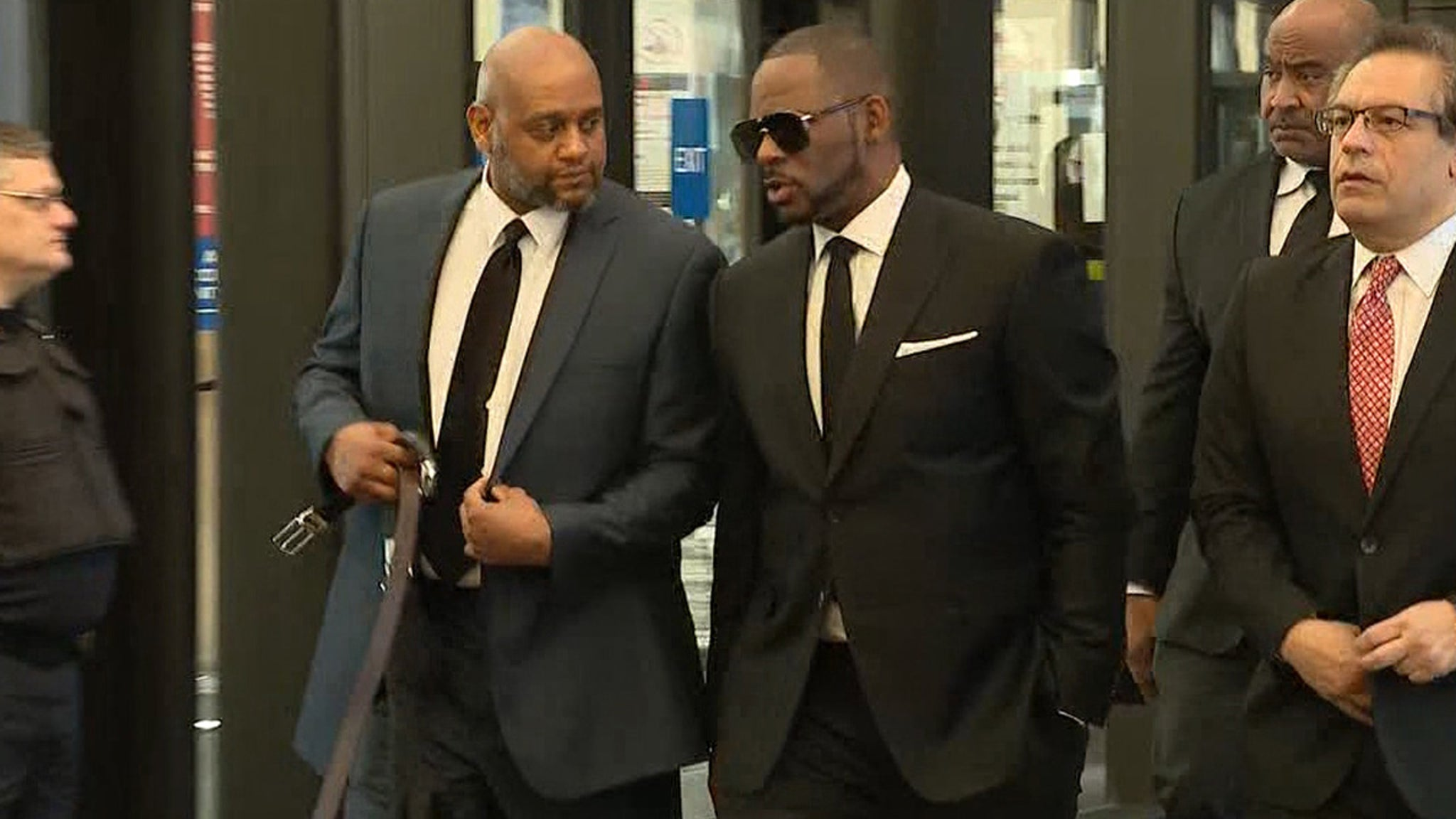 R Kelly Shows Up In Court With Legal Team