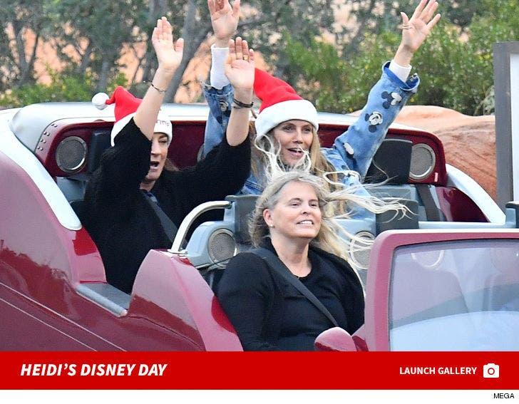 Heidi Klum and her boyfriend spend a fun day out at Disneyland