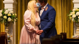 Coronavirus Wedding Couple Kisses Through Masks in New Orleans