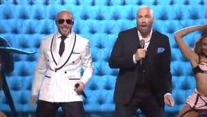 John Travolta Joins Pitbull for Epic Performance In Miami