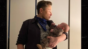 Elon Musk Posts Pic of Son, Jokes Infant's Spoon Skills are Lagging