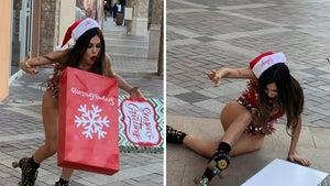 Liziane Gutierrez Takes a Spill on Skates in Christmas Bikini