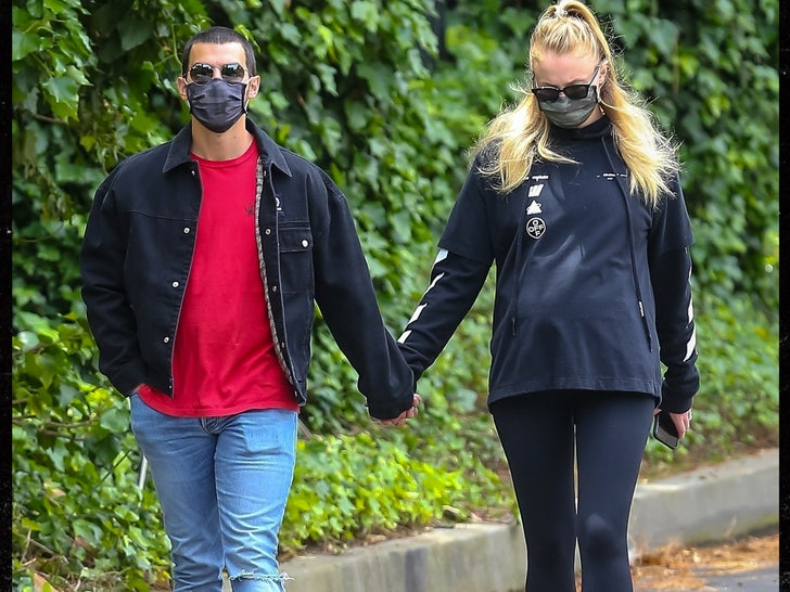 Sophie Turner Reveals Baby Bump On Walk With Joe Jonas