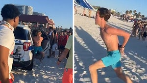 Spring Breaker Handcuffed but Flees from Cops, Beach Crowd Cheers Him On