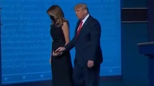 Melania Appears to Pull Hand Away from President Trump After Debate