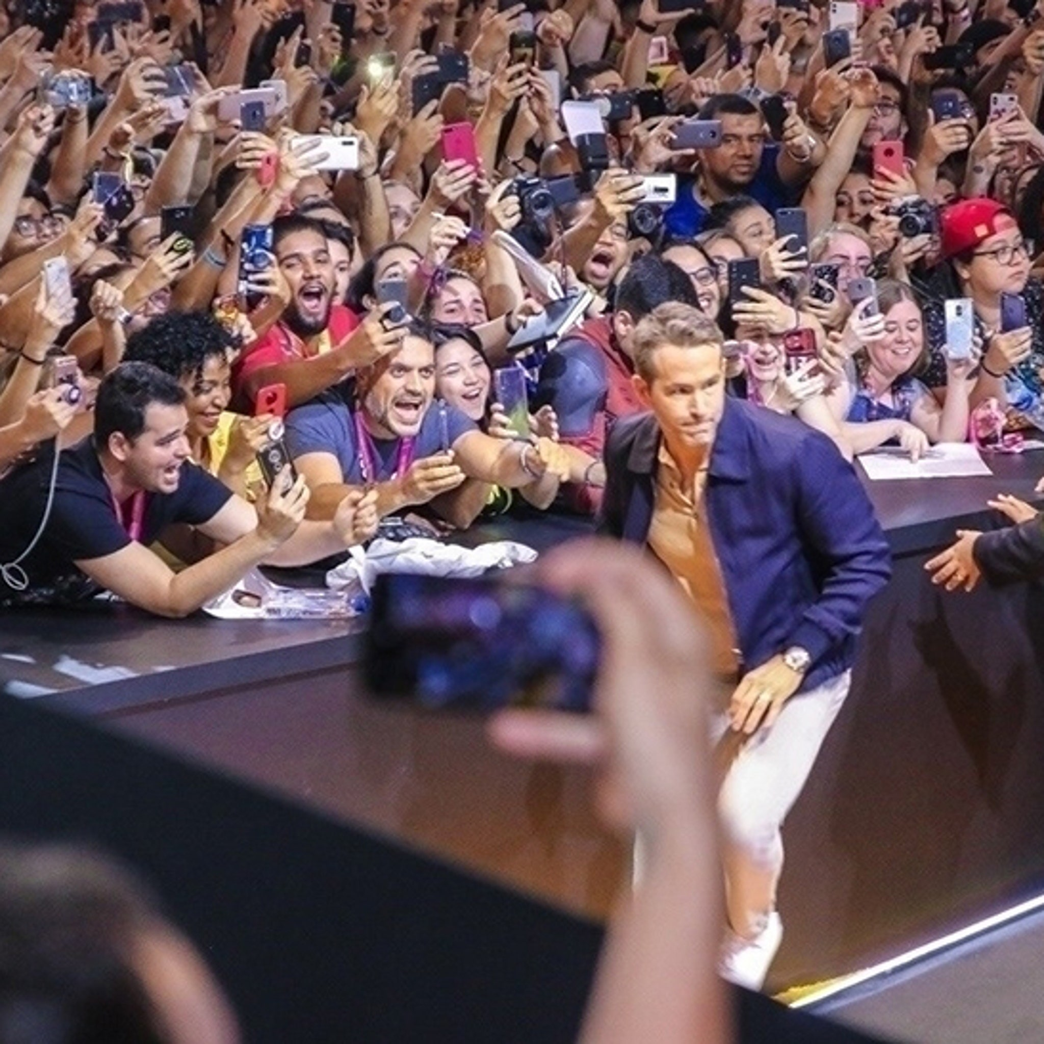 Ryan Reynolds Almost Crushed by Fans Swarming Over Barricade in Brazil