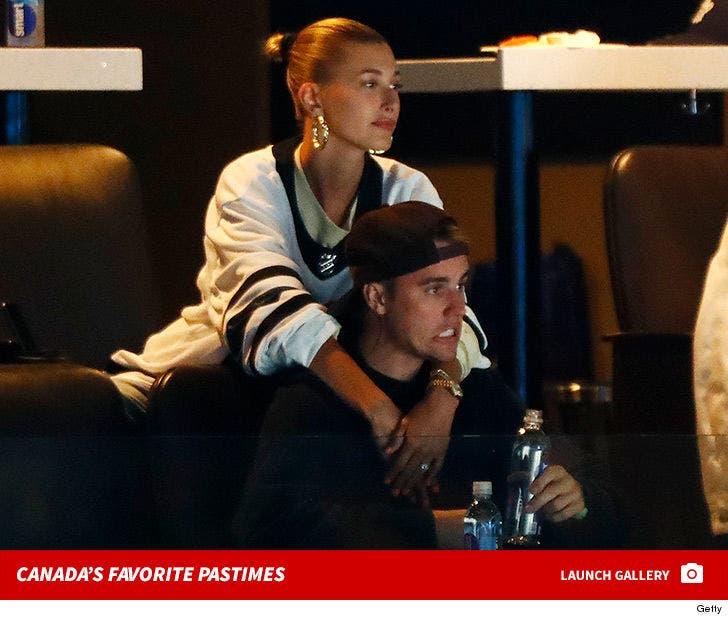 Justin Bieber and Hailey Baldwin -- Maple Leafs vs. Bruins Fans