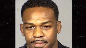 Jon Jones Allegedly Pulled Fiancee's Hair, Headbutted Cop Car During Arrest