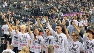 Hong Kong, Tibetan Activists Protest Raptors vs. Nets NBA Game