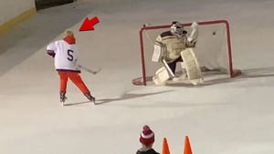 Justin Bieber Plays Hockey with Friends at Central Park Rink