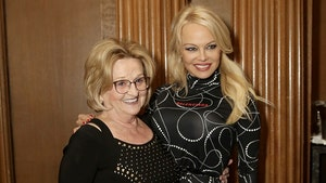 Pamela Anderson, Mom Look Proud as Foundation Raises Over $50k
