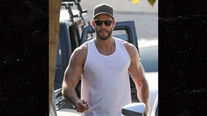 Liam Hemsworth Shows Off Massive Muscles After Gym Workout