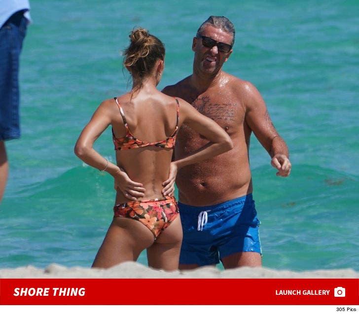 Petr Nedved Hits Beach With Bikini Model