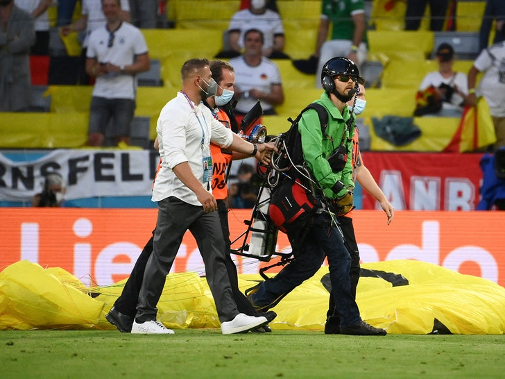 paraglider lands on the pitch during the UEFA Euro 2020 Championship Group F match between France and Germany