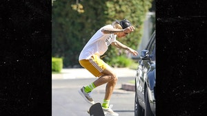 Justin Bieber Skateboarding Through New Neighborhood