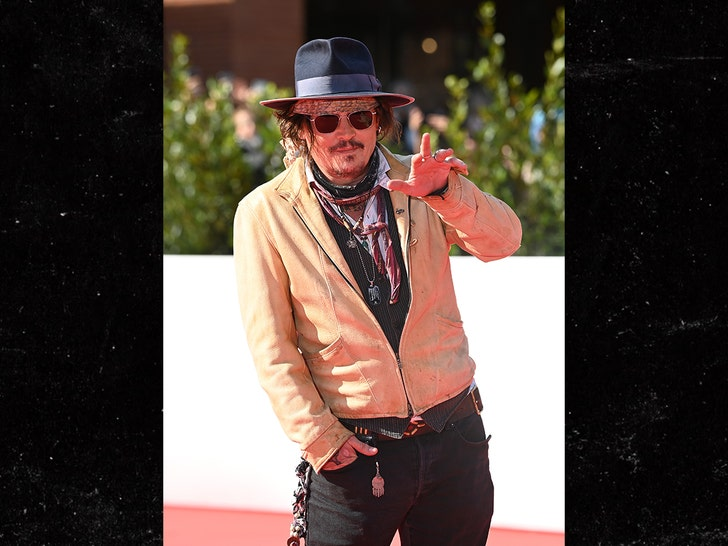 Johnny Depp Mobbed by Adoring Fans at Rome Film Festival, thank you
