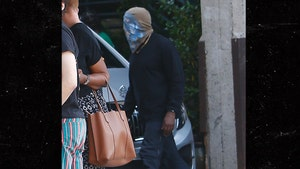 Kanye West Wears Bag-Like Face Covering in L.A.