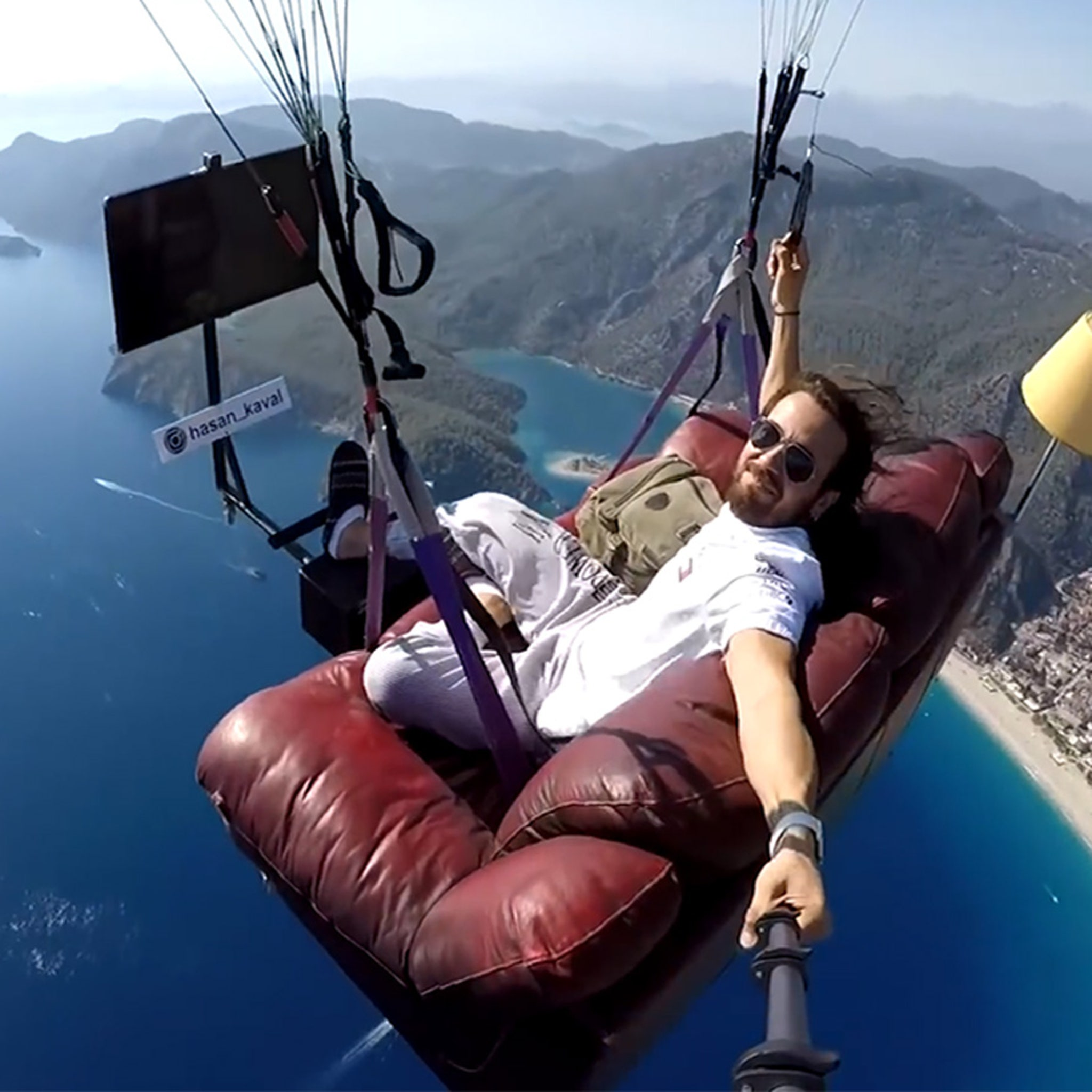 Turkish Man Becomes a Paragliding Couch Potato, TV & Sofa Included