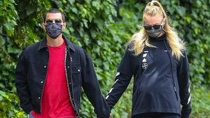 Sophie Turner Reveals Baby Bump on Walk with Joe Jonas