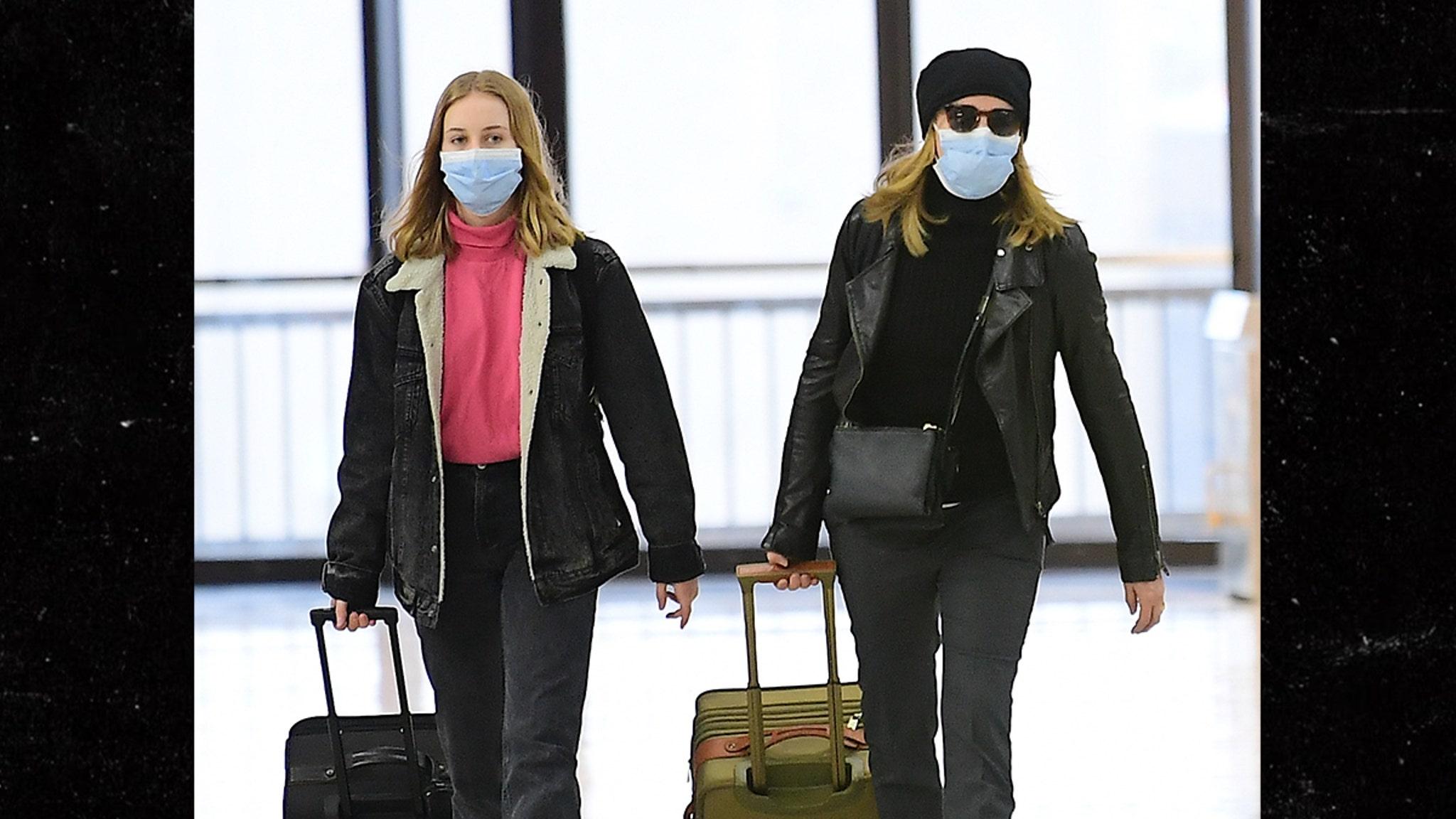 Felicity Huffman & Daughter Wear Masks at Airport Amid Coronavirus Scare