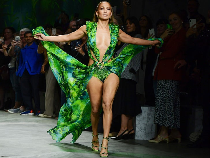 Jennifer lopez Brings Back Iconic Dress For Versace Fashion Show