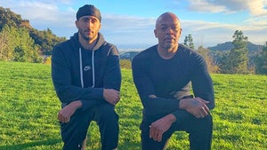 Dr. Dre Takes a Knee with Colin Kaepernick, 'Defiant'