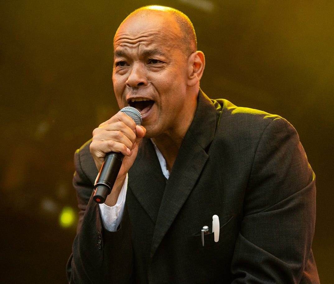 Roland Gift -- now 59 years old -- was photographed on stage a few years back looking like he just can't help himself.