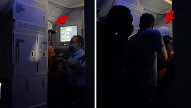 Delta Passengers Asked to Help Detain Man Who Tried Opening Plane Door.jpg