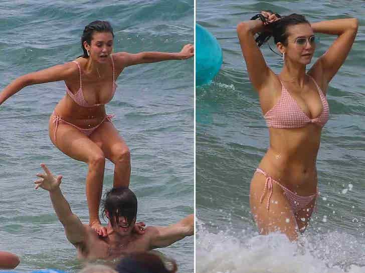 Nina Dobrev Enjoys A Day At The Beach With Her Boyfriend Grant Mellon