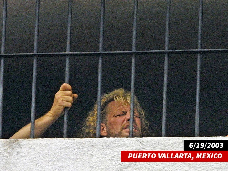 """Duane """"Dog"""" Chapman peers through the bars of the police station in Puerto Vallarta"""