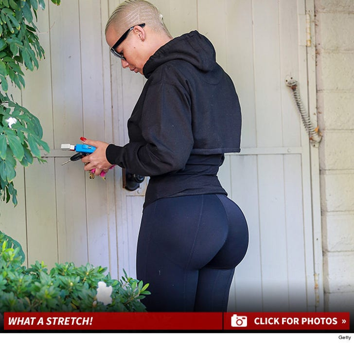 Amber Rose In Black Yoga Pants Will Make Your Day Better