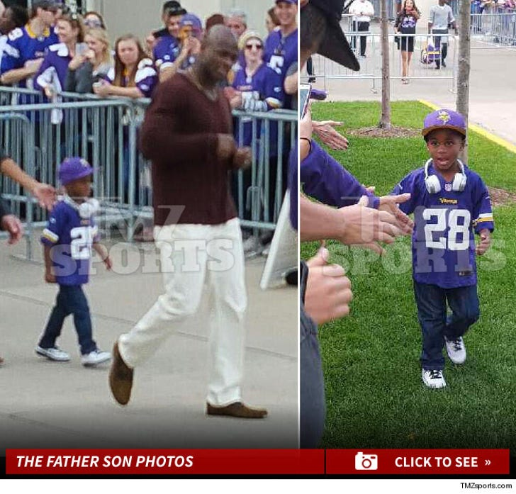 Adrian Peterson and Son -- The High Fivin' Photos