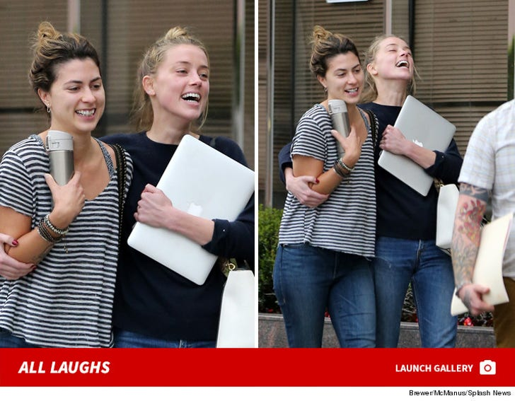 Amber Heard: All Smiles after Lawyer Pow Wow