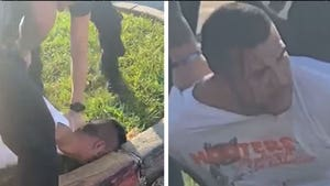 Police Slam Man's Head into Curb During Arrest