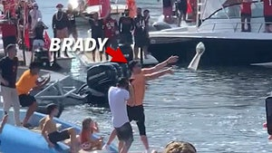 Tom Brady Tosses Lombardi Trophy Off Boat At Super Bowl Parade, It's Caught!