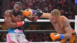 Jake Paul Beats Tyron Woodley, Claims He's Retired From Boxing
