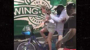 Rick Ross Narrowly Avoids Collision with NYC Bicyclist