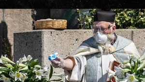 Priest Uses Squirt Gun Drive-Thru to Blast Holy Water at Parishioners
