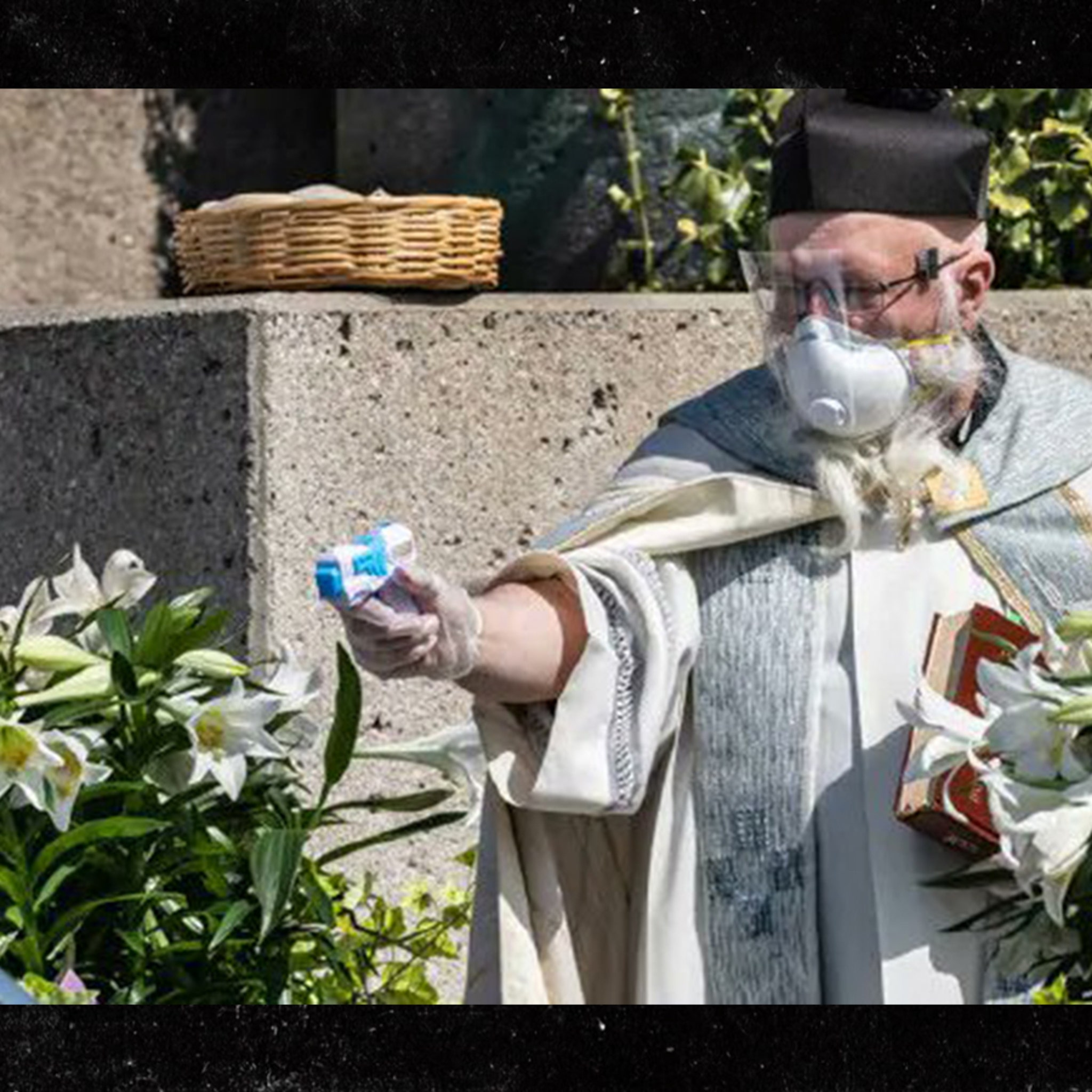 Priest Uses Squirt Gun Drive Thru To Blast Holy Water At Parishioners