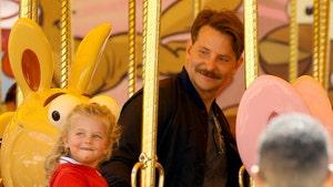Bradley Cooper Takes Daughter to Disneyland