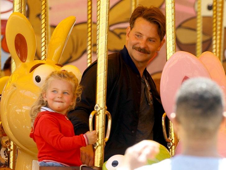 Bradley Cooper Is A Big Kid At Disneyland