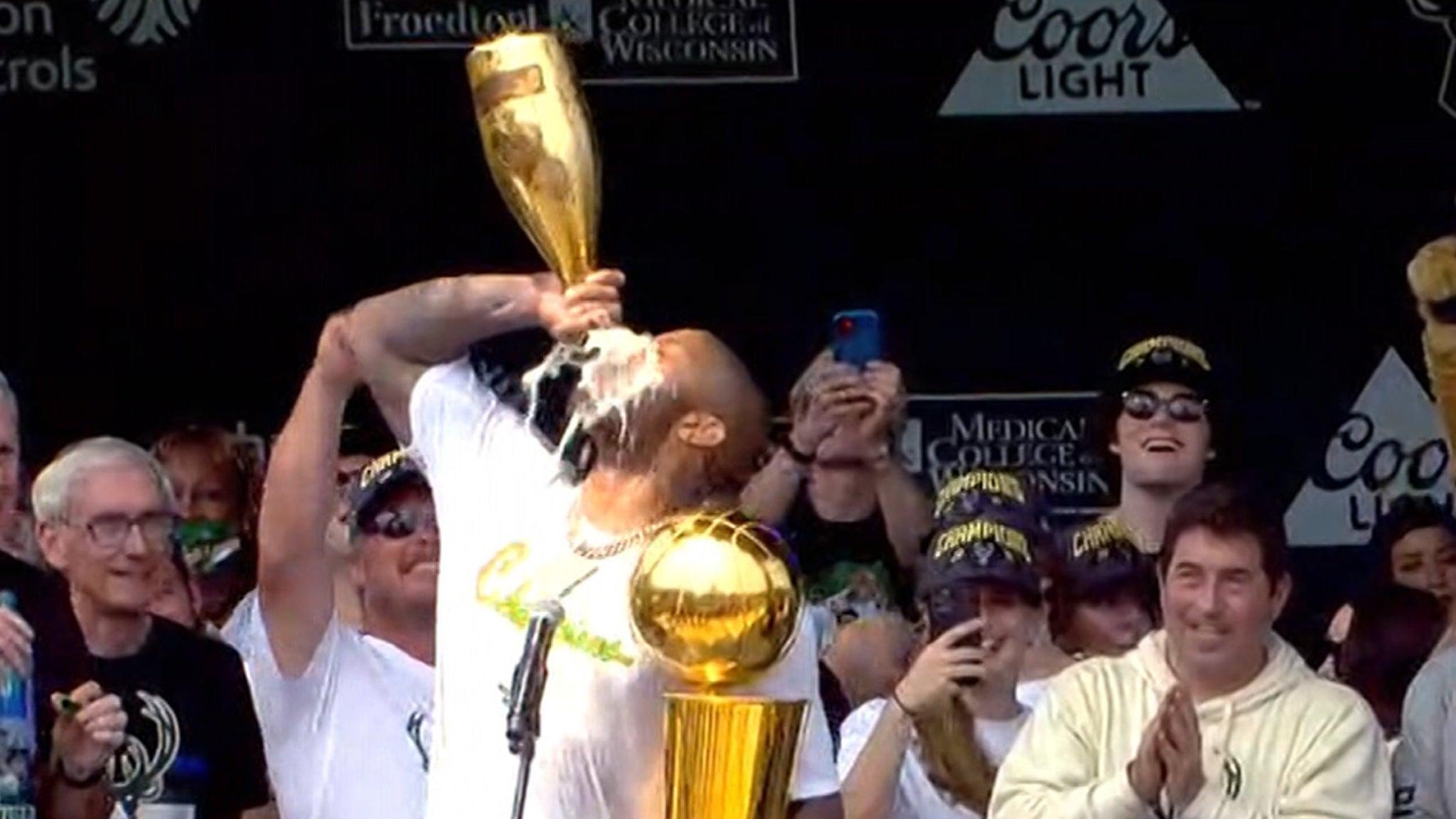 P.J. Tucker Chugs From Huge Champagne Bottle At Bucks' Championship Parade