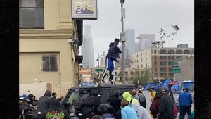 Blueface Makes it Rain on Skid Row for Christmas
