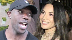 Terrell Owens Shoots Shot With Olivia Munn, 'She's Very, Very Sexy'
